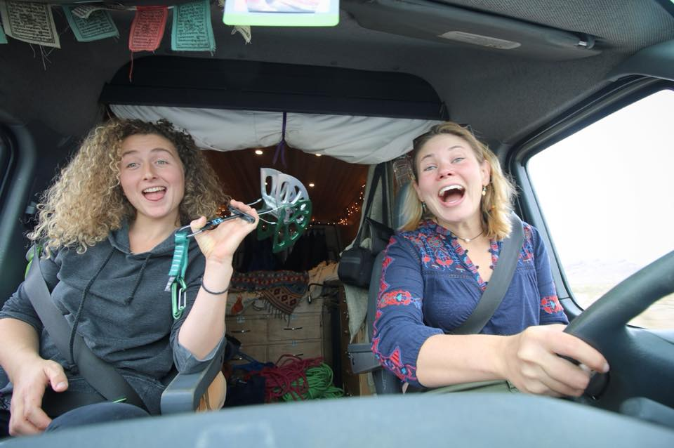Kaya Lindsay and Kate Sabo on a road trip holding a number 6 camalot