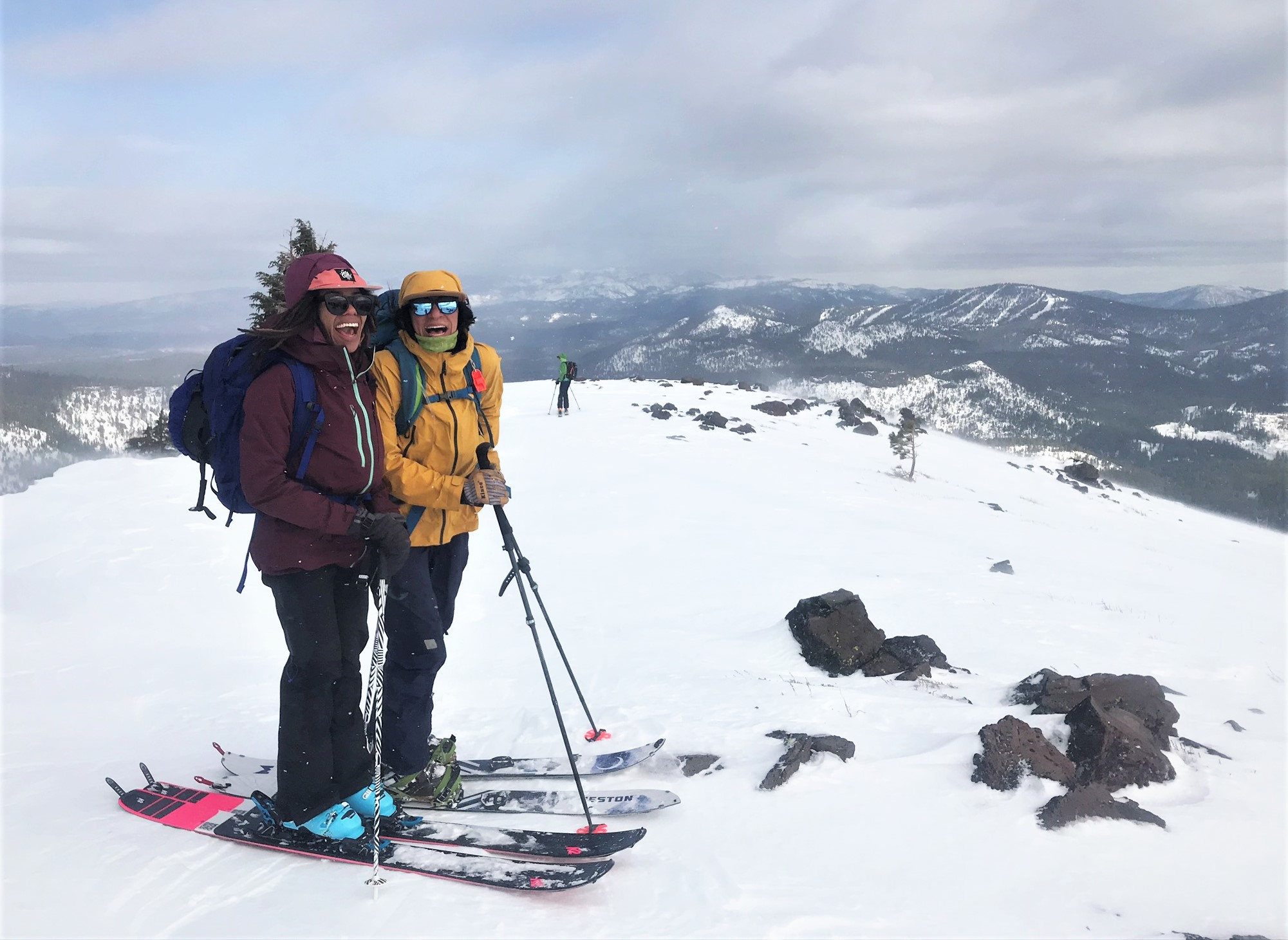 Two-women-of-color-backcountry-skiing-splitboarding-hut-trip