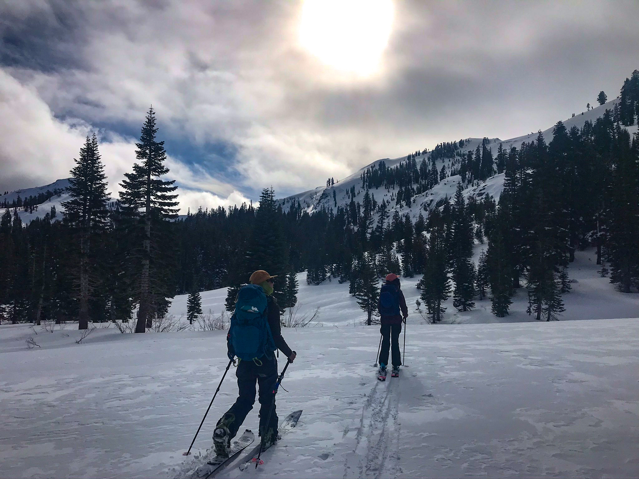 Two-women-ski-uphill-California-backcountry