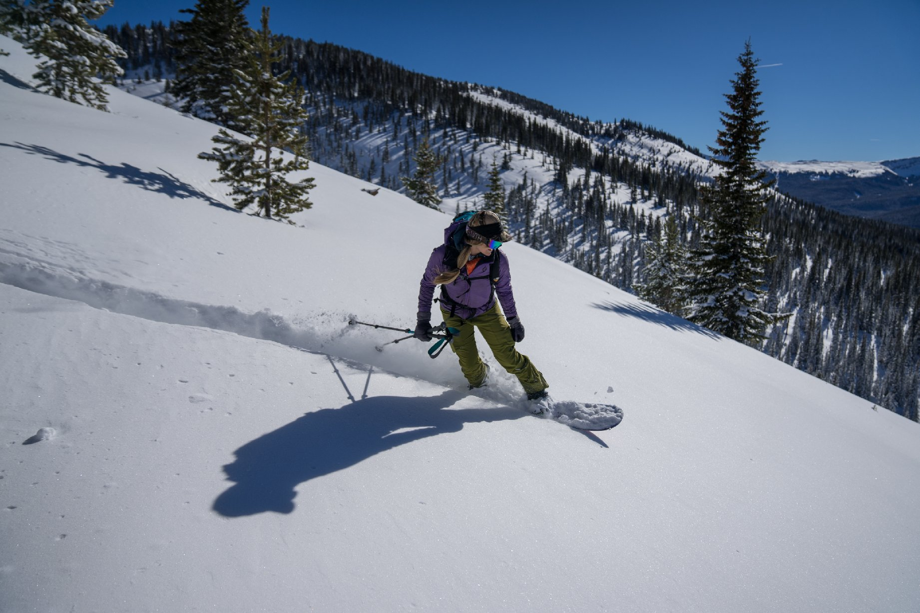 Sarah-MacGregor-snowboards-through-mellow-Colorado-backcountry.