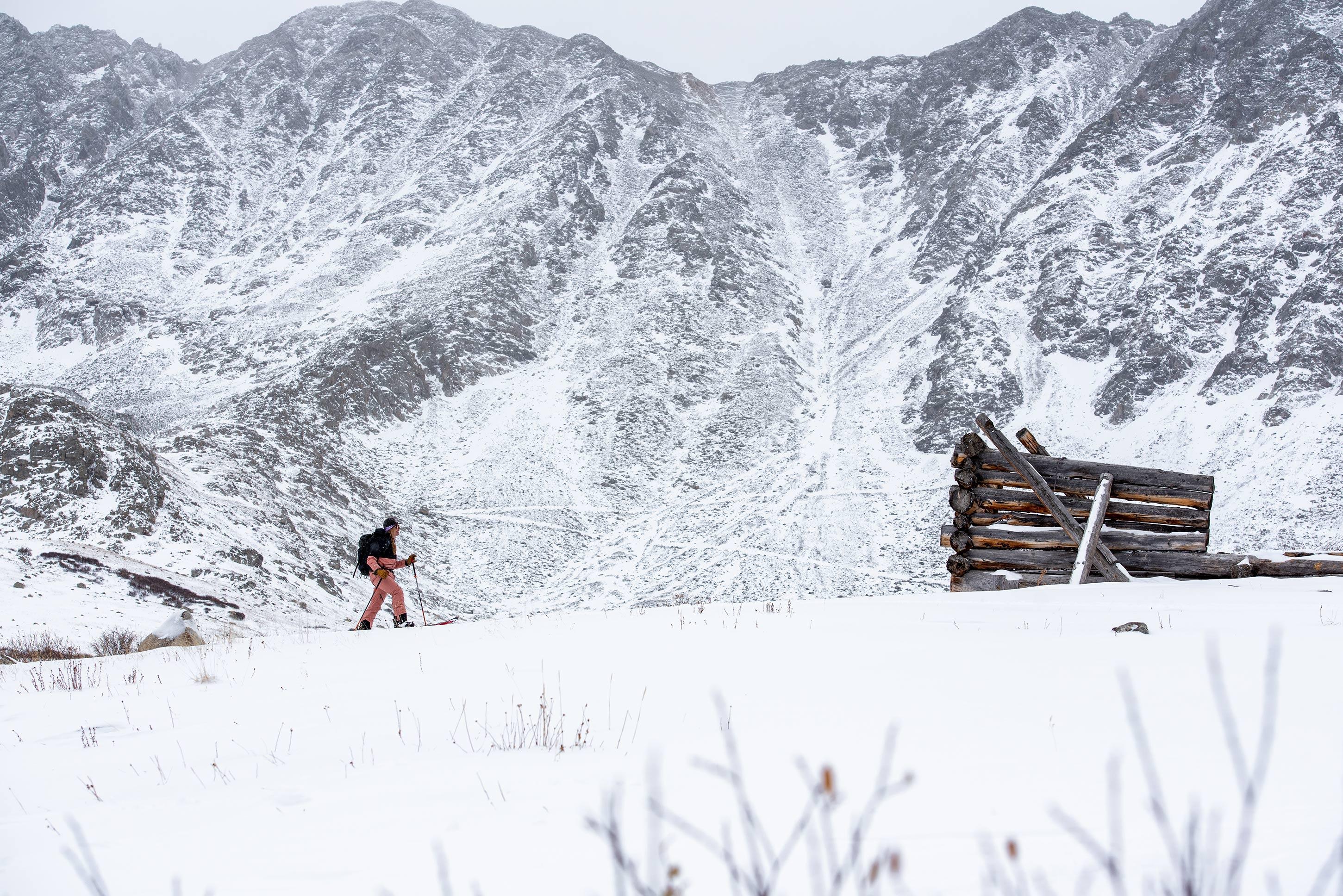 Alex Showerman splitboards up Mayflower Gulch Colorado - Photo by Carly Finke