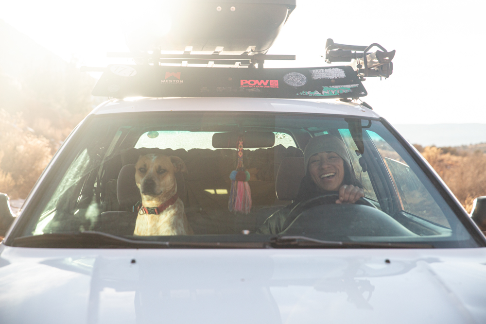 Mexican-Filipina-woman-prepared-to-drive-to-an-adventure-with-dog-friend
