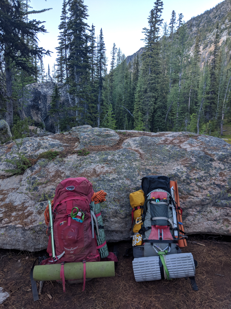 Two-climbers-backpacks-ready-for-descent-include-trash-leave-no-trace-leave-only-footprints