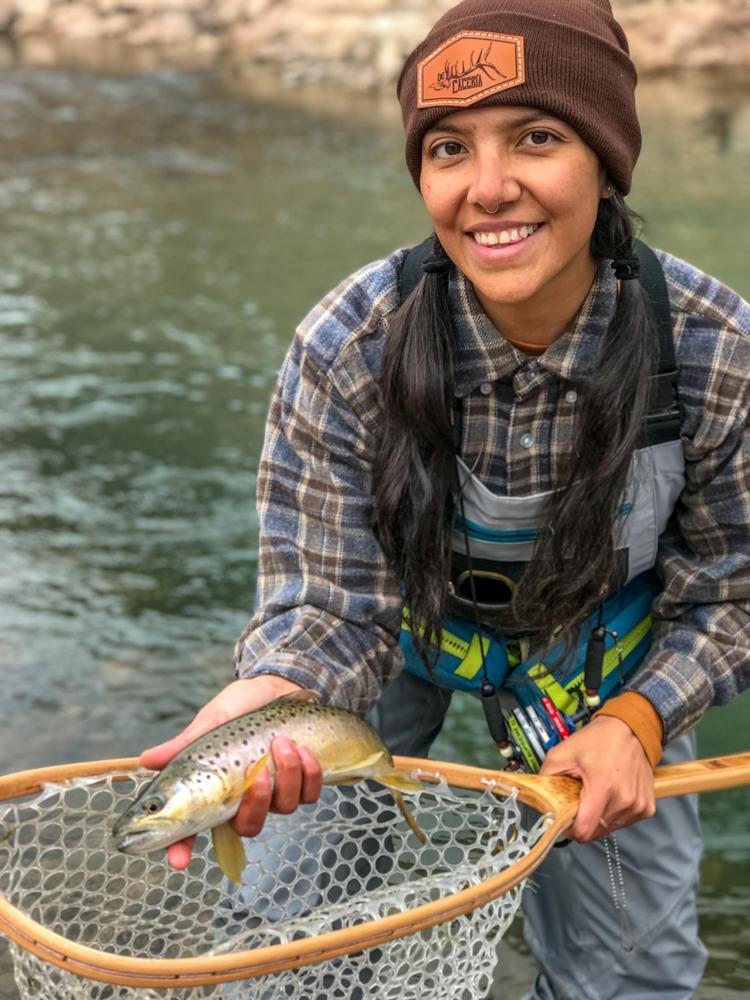 Gabaccia-Moreno-displays-catch-of-the-day-woman-flyfishing-Jicarilla-Apache-Land-Photo-Roberto-Flores-Buck